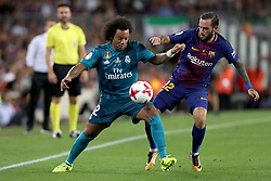 August 13, 2017 - Barcelona, Spain - Marcelo of Real Madrid duels for the ball with Aleix Vidal of FC Barcelona during the Spanish Super Cup football match between FC Barcelona and Real Madrid on August 13, 2017 at Camp Nou stadium in Barcelona, Spain. (Credit Image: © Manuel Blondeau via ZUMA Wire)