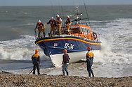 RNLI lifeboat being landed at Aldeburgh, East Anglia. Royal National Lifeboat .<br /> <br /> Visit our ENGLAND PHOTO COLLECTIONS for more photos to download or buy as wall art prints https://funkystock.photoshelter.com/gallery-collection/Pictures-Images-of-England-Photos-of-English-Historic-Landmark-Sites/C0000SnAAiGINuEQ