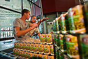 "Tanden Launder, left, and Kevin Jester of Architects West draw up some plans of how best to construct the ""Canned Food Castle"" at the Salvation Army Kroc Center in Coeur d'Alene on Friday. The Kroc Center bought $2000 worth of canned goods to to towards the ""canstruction"" and will stay up all weekend during the Emergency Community Food Drive."