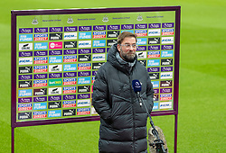 NEWCASTLE-UPON-TYNE, ENGLAND - Wednesday, December 30, 2020: Liverpool's manager Jürgen Klopp gives a television interview before the FA Premier League match between Newcastle United FC and Liverpool FC at St. James' Park. The game ended in a goal-less draw. (Pic by David Rawcliffe/Propaganda)