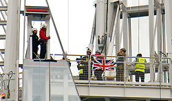 © London News Pictures. 03/09/2012. London, UK.  Prince Andrew (far left in black) waiting to start his descent. Prince Andrew, The Duke of York abseiling down The Shard building in Central London on September 3, 2012. The Prince joined Ffion Hague billionaire John Caudwell and a team of 37 others to take part in a charity abseil down London's tallest building to raises funds for The Outward Bound Trust and the Royal Marines Charitable Trust Fund. Photo credit: Ben Cawthra/LNP