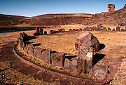 PERU, LAKE TITICACA Aymara Culture 1000AD, pre-Inca observatories at Sillustani near Puno, chullpa tombs on hillside beyond