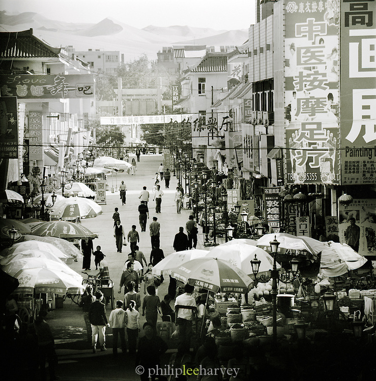 A busy street in Dunhuang, a town along the old Silk Route in Jiuquan, Gansu province, China