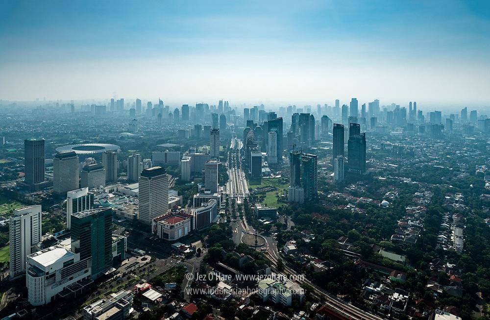Looking north at Jakarta city from between Senayan (LHS), the southern part of Jalan Jenderal Sudirman (center), Jalan Senopati & SCBD (mid RHS), Indonesia.