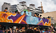 People celebrating Mardi Gras in New Orleans on Mardi Gras day near the partially collapsed Hard Rock Cafe  Hotel. A few flours of the hotel pancked while it was still undercontrctuin o Oct. 12, 2019, killing at least three workers. Two of the bodies remain trapped inside.