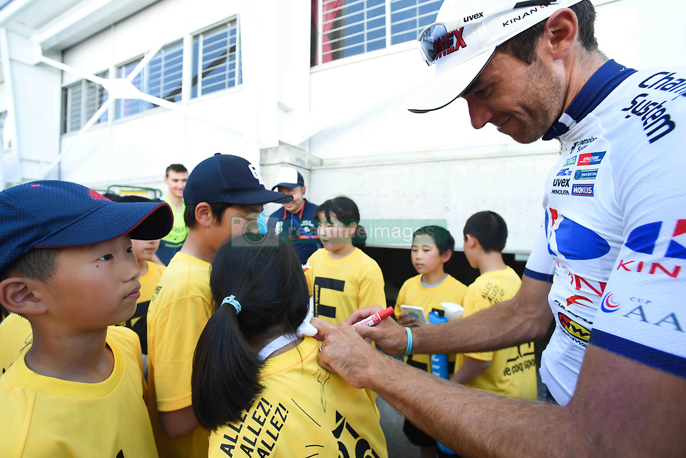 May 24, 2018 - Japan - French rider Thomas Lebas from Kinan Cycling Team signs autographs to a group of young fans after  Minami Shinshu stage, 123.6km on Shimohisakata Circuit race, the fifth stage of Tour of Japan 2018. Jorge Camilo Castiblanco Cubides from Illuminate Team finishes second, and the main group finishes 1 minute and 19 seconds behind the winner. Thomas Lebas takes the Race Leader Green Jersey with three stages to go..On Thursday, May 24, 2018, in Lida, Nagano Prefecture, Japan. (Credit Image: © Artur Widak/NurPhoto via ZUMA Press)