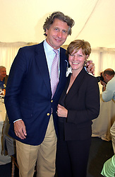 """ARNAUD BAMBERGER and the COUNTESS OF MARCH at a luncheon hosted by Cartier at the 2004 Goodwood Festival of Speed on 27th June 2004.  Cartier sponsored the """"Style Et Luxe' for vintage cars on the final day of this annual event at Goodwood House, West Sussex."""
