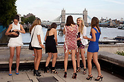 Select models take a breather outside by the Thames, with Tower bridge in background. Fifty finalists voted for by tens of thousands via face book made it to the London final. They were put through their paces, had modelling lessons and made up by top professionals. In the evening friends and Next customer competition winners attended a party and fashion show hosted by Alesha Dixon and Paul Sculfor where the eventual winners Dan Clarke, 26, and Kiren Modi,20, were decided upon by industry leaders.
