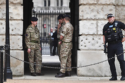 © Licensed to London News Pictures. 16/09/2017. London, UK. A soldier and Armed police watch over at House Guards in Westminster, London the day after a bomb partly exploded on a tube train at Parsons Green station in London injuring members of the public. Operation temperer has been put in to place after the UK terror threat level was raised to critical. Photo credit: Ben Cawthra/LNP
