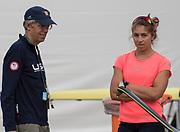 "Rio de Janeiro. BRAZIL.   USA W1X, Gevvie STONE with coach, Greg STONE, checking and adjusting the rigging, 2016 Olympic Rowing Regatta. Lagoa Stadium,<br /> Copacabana,  ""Olympic Summer Games""<br /> Rodrigo de Freitas Lagoon, Lagoa.   Tuesday  09/08/2016 <br /> <br /> [Mandatory Credit; Peter SPURRIER/Intersport Images]"