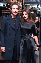 JULIA RESTOIN-ROITFELD and ROBERT KONJIC at a party hosted by InStyle to celebrate the iconic glamour of Dolce & Gabbana held at D&G, 6 Old Bond Street, London on 3rd November 2010.