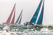 Vestas- 11th hour racing, Mapfre, and Brunel sail off into a light haze and big swell of Castle Hill in Newport