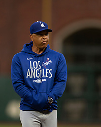 Oct 7, 2021; San Francisco, CA, USA; Los Angeles Dodgers manager Dave Roberts (30) watches his team during NLDS workouts. Mandatory Credit: D. Ross Cameron-USA TODAY Sports