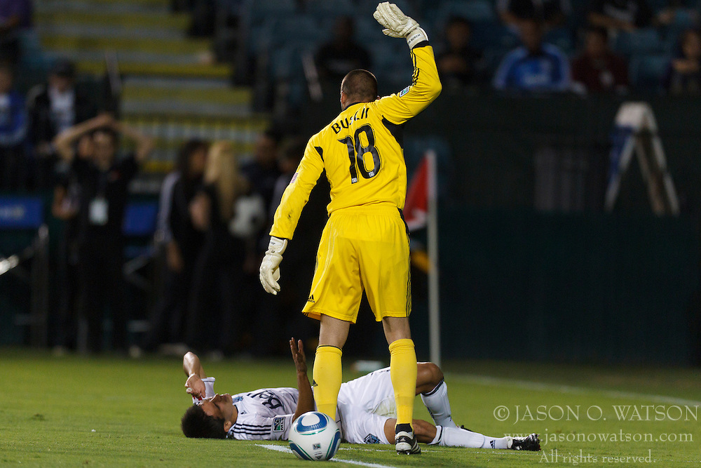 July 20, 2011; Santa Clara, CA, USA;  San Jose Earthquakes goalkeeper Jon Busch (18) taunts Vancouver Whitecaps midfielder Shea Salinas (22) while laying in front of the goal during the second half at Buck Shaw Stadium. San Jose tied Vancouver 2-2.