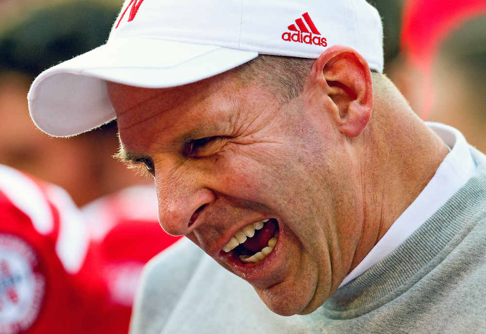 Nebraska head coach Bo Pelini talks with his team on the sidelines at the end of the first quarter of Saturday's game against Minnesota at Memorial Stadium. (Independent/Matt Dixon)