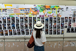 Pro democracy and anti extradition law protests slogans and posters in Hong Kong. 24 September 2019. Large so-called Lennon Wall in pedestrian subway at Tsim Sha Tsui station in Kowloon. Graffiti and posters denouncing  extradition law proposed by Government are fixed to walls with many anti China posters and messages.
