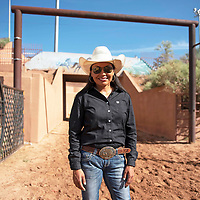 Tara Seaton of Delkon, Arizona poses for a photo Thursday morning at Red Rock Park in Churchrock. Seaton won the Iron Girl Challenge in barrel racing Wednesday evening.