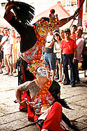 Two dancers, said to be possessed by the spirit of Taoist Gods, dance at a religious ceremony in Tainan, Taiwan.