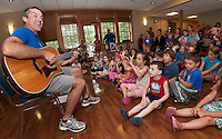 "Paul Warnick brings music and smiles to kick off the ""Dream Big"" Summer Reading program at Gilford Library on Monday afternoon.   (Karen Bobotas/for the Laconia Daily Sun)"