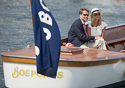 © London News Pictures. 05/07/2012.  Henley-on-Thames, UK. A couple enjoy a boat ride on day three of Henley Royal Regatta on the River Thames at Henley-on-Thames, Oxfordshire on July 03, 2013. The 5 day regatta over the first weekend in July, races head-to-head knock out competitions over a course of 1 mile between rowing teams from throughout the world. Photo credit: Ben Cawthra/LNP