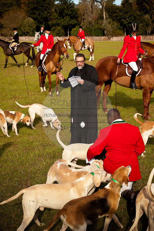 Rev. Dick Reed of St. James Church bless the foxhounds and fox hunters at the start of the fox hunting season November 29, 2009 at Middleton Place plantation in Charleston, SC. The hunt is a drag hunt where a scented cloth is used instead of live fox