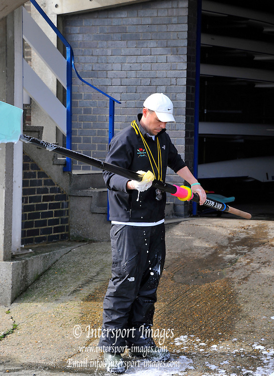 London, UK,  2014 Varsity, Annual Tideway Week. CUBC, Cambridge University Boat Club, Mark BEER, Assistant Coach, washes the oars. 05:16:02  Saturday  05/04/2014  : [Mandatory Credit Intersport Images]