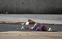 November 19, 2018 - Baltimore, MD, USA - A child's doll lays next to police shooting tags as Baltimore City Police officers investigate the scene of a shooting at the 1000 block of McKean Avenue, where a 5-year-old was shot, on Monday, Nov. 19, 2018. (Credit Image: © Kenneth K. Lam/Baltimore Sun/TNS via ZUMA Wire)