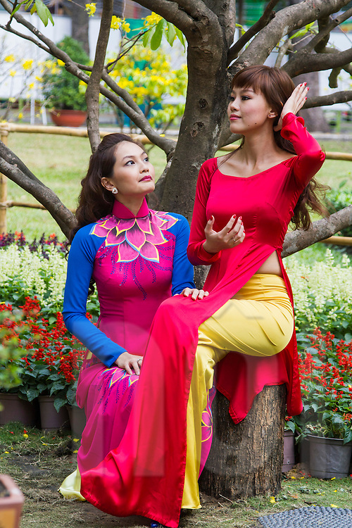 Portrait of painters Pham Minh Nguyet & Kim Ngan dressed in traditional Ao Dai, Ho Chi Minh City, Vietnam, Southeasst Asia