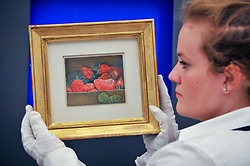 """© Licensed to London News Pictures. 15/06/2017. London, UK. A staff member shows """"Strawberries"""", 1950, by Lucien Freud (estimate GBP550k-750k).  Preview of Impressionist and Modern art sale, which will take place at Sotheby's New Bond Street on 21 June.  Photo credit : Stephen Chung/LNP"""