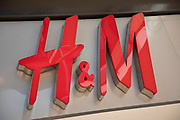 Sign for the high street clothing brand H&M in Birmingham, United Kingdom.