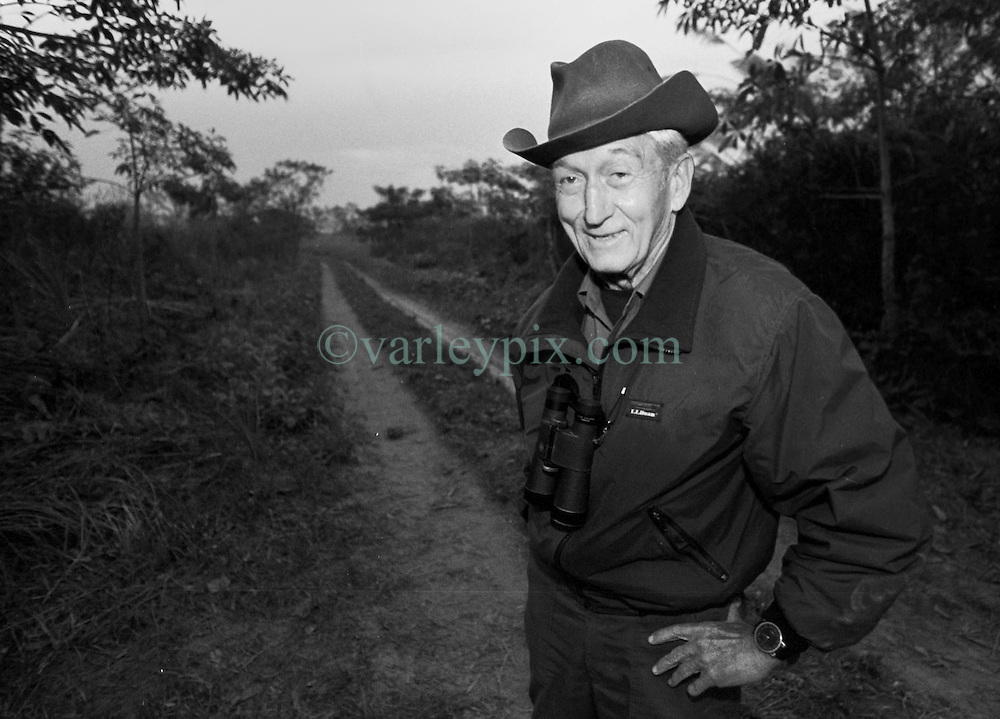 December 1999. Royal Chitwan National Park, Nepal.<br /> World renowned tiger ecologist, conservationist, researcher and writer Chuck McDougal stands on a track in the jungle as he and his team prepare to track the elusive jungle cats. <br /> Charles McDougal died on 11 May in Kathmandu surrounded by his family.<br /> Photo© Charlie Varley/varleypix.com