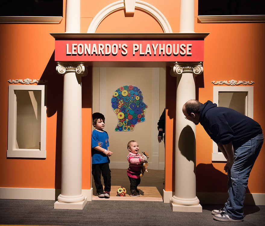 Mara Lavitt -- Special to the Hartford Courant<br /> February 3, 2016<br /> The Leonardo da Vinci: Machines in Motion exhibit at the Connecticut Science Center in Hartford. Siblings Jacob DeMayo age 4, left, and Gwen Etcheto age 1 both of Waterbury and their godfather Kyle Litke of Naugatuck play in Leonardo's Playhousen in the workshop area of the exhibit.