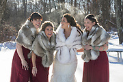 Bridesmaids and bride in the snow