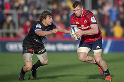 December 9, 2018 - Limerick, Ireland - Peter O'Mahony of Munster in action with Florian Vialelle of Castres during the Heineken Champions Cup Round 3 match between Munster Rugby and Castres Qlympique at Thomond Park Stadium in Limerick, Ireland on December 9, 2018  (Credit Image: © Andrew Surma/NurPhoto via ZUMA Press)