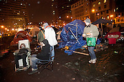 Occupy Boston members are seen in a cold weather at night in Boston, Massachusetts, December 10, 2011.