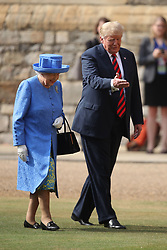 US President Donald Trump and Queen Elizabeth II inspect a Guard of Honour at Windsor Castle, Windsor.