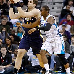 December 17, 2010; New Orleans, LA, USA; New Orleans Hornets point guard Chris Paul (3) defends against Utah Jazz center Kyrylo Fesenko (44) during the second half at the New Orleans Arena.  The Hornets defeated the Jazz 100-71. Mandatory Credit: Derick E. Hingle
