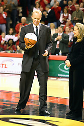 03 February 2007: Doug Collins and his wife stand at center court as the playing service in Redbird Arena is dedicated as Doug Collins Court. In what is locally referred to as the War on Seventy Four, the Bradley Braves defeated the Illinois State University Redbirds 70-62 on Doug Collins Court inside Redbird Arena in Normal Illinois.