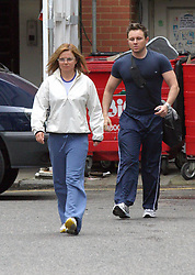 Apr 20, 2004; London, UK;  !! Ex Spice Girls GERI HALLIWELL has furniture delivered to her house before flashing her pink thong while heading to the gym with her trainer, which she needs to get going on to reconnect with her perfect figure which she lost relaxing in Los Angeles. As they leave the gym the trainer seems to have trouble keeping up with her as they head home (Credit Image: © SP033/ZBP/ZUMAPRESS.com)