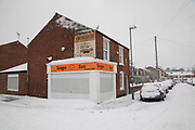 Tanning salon in Kings Heath duringheavy snow fall on Sunday 10th December 2017 in Birmingham, United Kingdom. Deep snow arrived in much of the UK, closing roads and making driving treacherous, while many people simply enjoyed the weather.