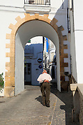 Traditional whitewashed buildings in Vejer de la Frontera, Cadiz Province, Spain old man walking in street
