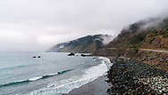 Fog clings to the mountains and ocean along the Mendocino coast in California