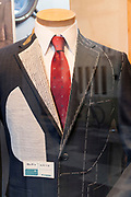 business suite window display at tailor shop Japan