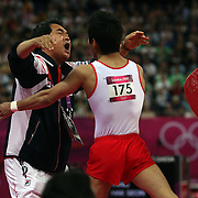 Hak Seon Yang, Korea, is congratulated by Coach Cho Sung-doe after winning the Gold Medal in the Gymnastics Artistic, Men's Apparatus, Vault Final at the London 2012 Olympic games. London, UK. 6th August 2012. Photo Tim Clayton