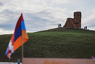 """The flag of the Nagorno-Karabakh Republic, locally called Artsakh, is seen at a souvenir stand at the  """"We Are Our Mountains"""" monument, located on the outskirts of Stepanakert. The sculpture, hewn from volcanic tufa and completed in 1967 by Sargis Baghdasaryan, depicts an old man and woman who represent the mountain people of Karabakh.<br /> <br /> (September 22, 2016)"""
