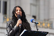 San Francisco, USA. 19th January, 2019. The Women's March San Francisco begins with a rally at Civic Center Plaza in front of City Hall. Writer and consultant Natasha Singh, who works closely with Asha Rising, Freedom forward, and Center for Domestic Peace, addresses the crowd. Her writing has appeared in The Atlantic, The New York Times and several anthologies. Credit: Shelly Rivoli/Alamy Live News