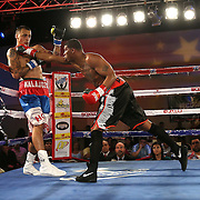 Larry Pryor (R) catches Radivvoje Kalajdzic with a right hand during the Telemundo Boxeo boxing match at the A La Carte Pavilion on Friday,  March 13, 2015 in Tampa, Florida.  Kalajdzic  won the bout after the referee stopped the fight. (AP Photo/Alex Menendez)