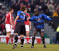 Photo. Glyn Thomas.<br /> Gillingham v Charlton. FA Cup Third Round.<br /> Priestfield Stadium. 03/01/2004.<br /> Gillingham's Mamady Sidibe (R) is congratulated on scoring his side's second goal by Nicky Southall.