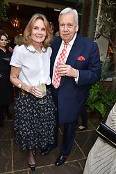 Lady Mary-Gaye Curzon and David Mcdonough at The Ivy Chelsea Garden Summer Party, Kings Road, London, England. 14 May 2018.