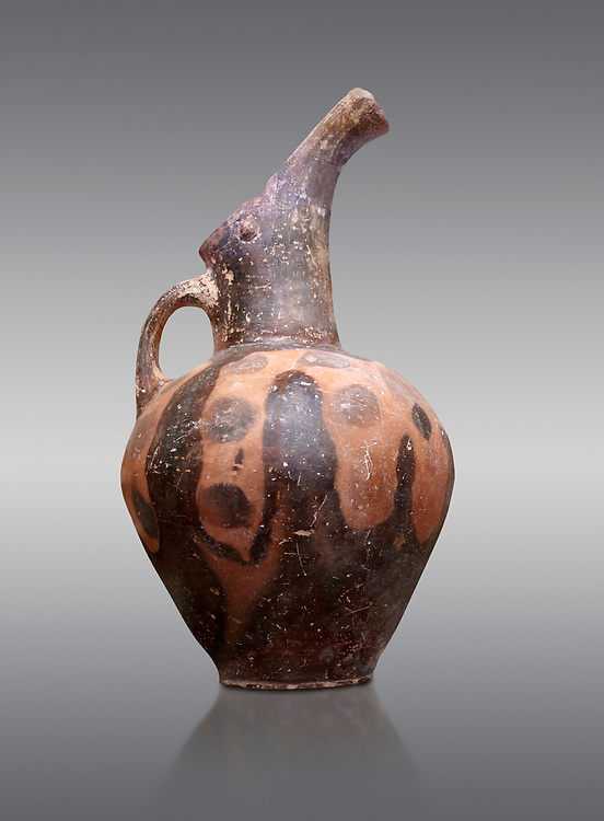 Vasiliki Ware jug with characteristic mottled decorations,  Vasiliki 2300-1900 BC BC, Heraklion Archaeological  Museum, grey background. .<br /> <br /> If you prefer to buy from our ALAMY PHOTO LIBRARY  Collection visit : https://www.alamy.com/portfolio/paul-williams-funkystock/minoan-art-artefacts.html . Type -   Heraklion   - into the LOWER SEARCH WITHIN GALLERY box. Refine search by adding background colour, place, museum etc<br /> <br /> Visit our MINOAN ART PHOTO COLLECTIONS for more photos to download  as wall art prints https://funkystock.photoshelter.com/gallery-collection/Ancient-Minoans-Art-Artefacts-Antiquities-Historic-Places-Pictures-Images-of/C0000ricT2SU_M9w